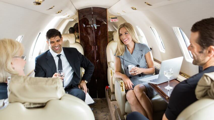 group of people on a private jet