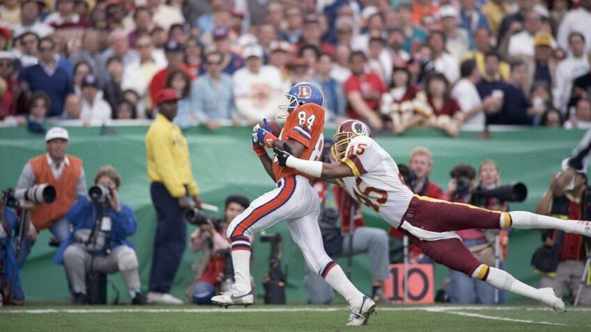Washington Redskins cornerback Barry Wilburn (45) tries to stop Denver Broncos Ricky Nattiel (84) from getting into the endzone after Nattiel hauled in pass from quarterback John Elway during first quarter of Super Bowl XXII, in San Diego.