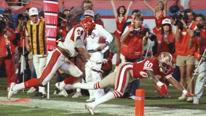 San Francisco 49ers wide receiver Jerry Rice (80) dives into the end zone for a touchdown during third quarter action in Super Bowl XXIII game against the Cincinnati Bengals in Miami, Fla.