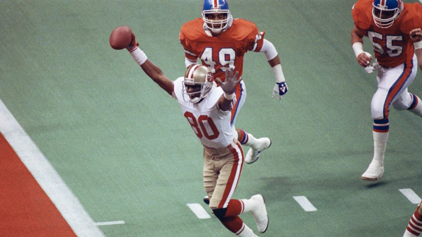 San Francisco 49ers wide receiver Jerry Rice celebrates his first-quarter touchdown against the Denver Broncos during NFL football's Super Bowl XXIV in New Orleans.