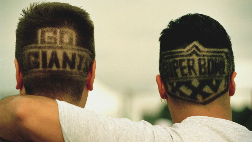 New York Giants fans Ron Kilbride, left, and Vincent Savino, both of New New City, sport the lastest in Hair-dos to show their support of their favorite team in the Super Bowl.