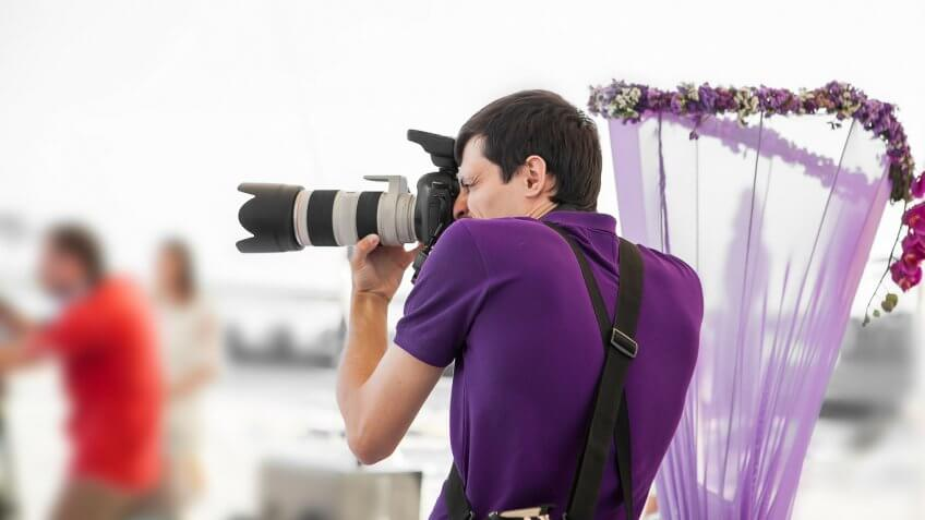 man photographing a wedding