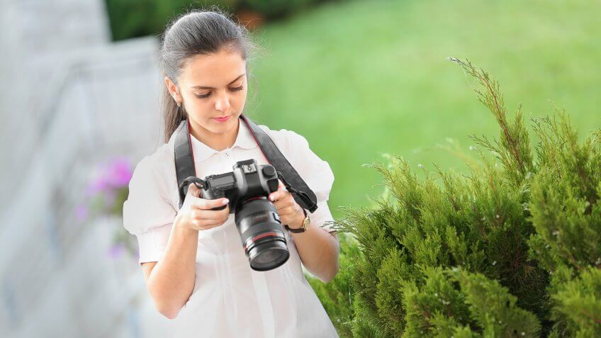 young woman using a camera