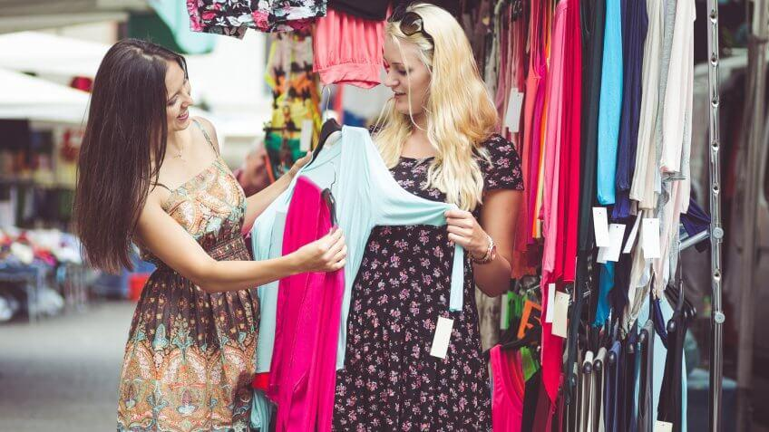 two young women shopping for clothing