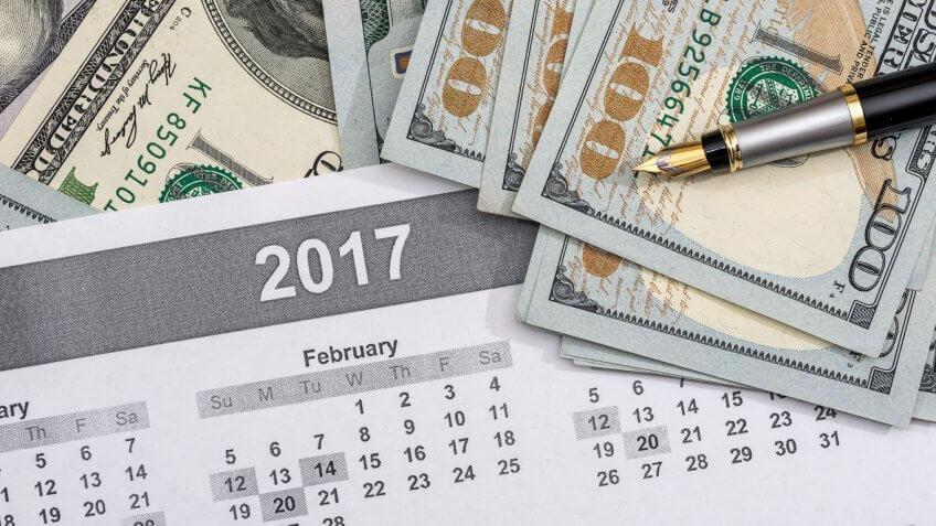 $100 bills on a 2017 calendar