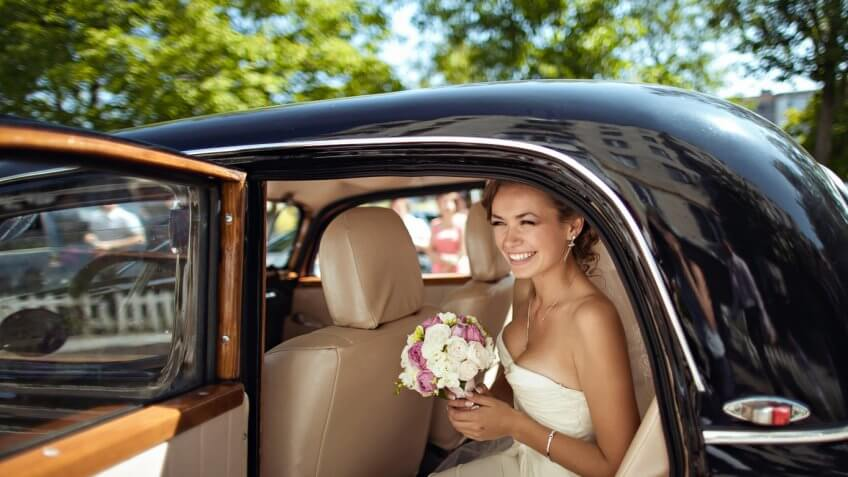 bride coming out of a car