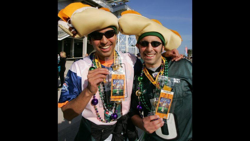 Philadelphia Eagles Fans Indra Chandra (l) and Joshua Partnow Both of Philadelphia Pennsylvania Show Off the Two Super Bowl Tickets They Purchased For $2500 Usd Each Outside Alltel Stadium in Jacksonville Florida Several Hours Before the Start of Super Bowl Xxxix Sunday 06 February 2005 the Afc Champion New England Patriots Will Face the Nfc Champion Philadelphia Eagles in the National Football League's Annual Championship GameUsa Nfl Super Bowl Xxxix - Feb 2005.