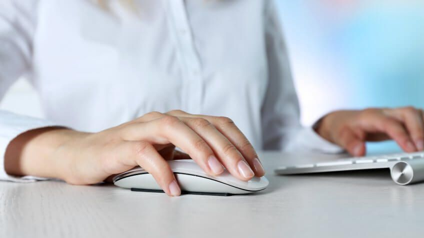 person using a keyboard and mouse