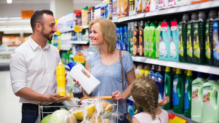 young family shopping for cleaning products at a grocery supermarket