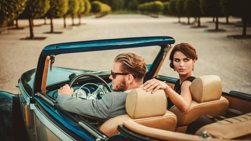 stylish young couple in a convertible
