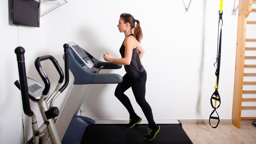 woman running on a treadmill in the gym