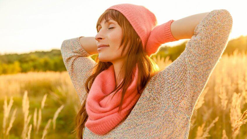 woman looking relaxed outside