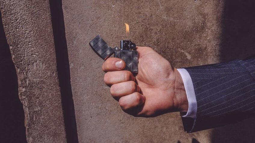 hand holding a Zippo lighter