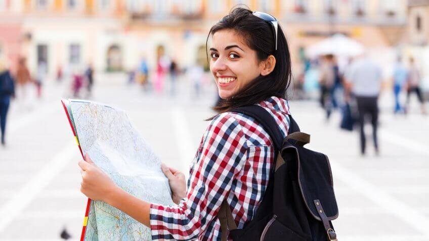 woman tourist holding a map