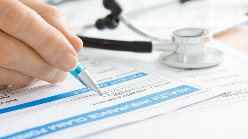 Person filling out a health insurance claim form
