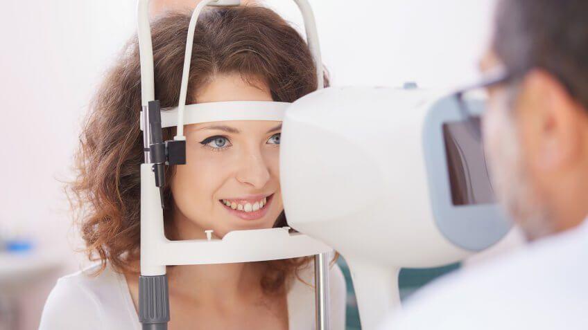 woman getting an eye exam with an optometrist