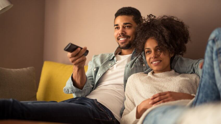 young couple watching tv together television