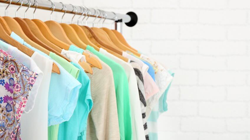 rack of hung up bright clothing