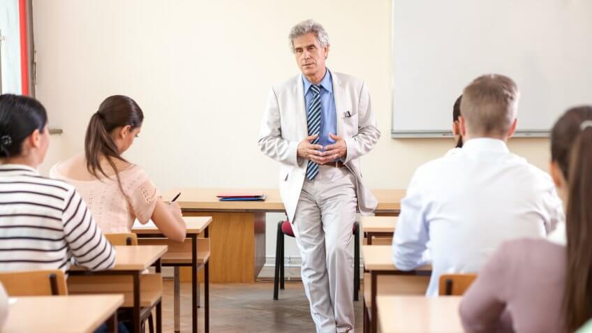 older senior professor teaching a class