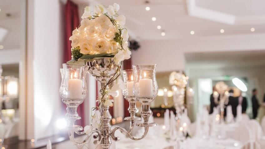 floral arrangement with candles at a wedding