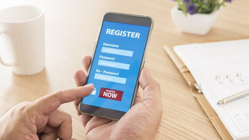 person registering for an account on their smartphone