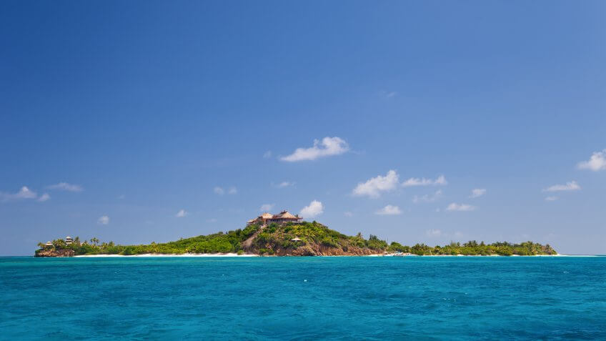 view of luxurious Necker Island, British Virgin Islands taken from a boat.