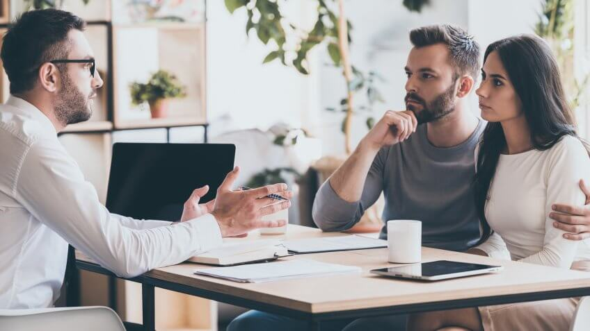 couple listening to financial consultant