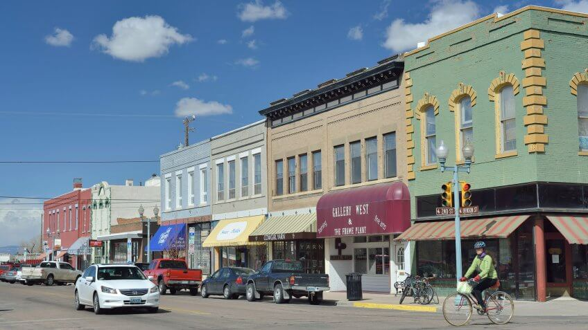 Laramie, Wyoming, USA - March 30, 2013: Downtown Laramie, Wyoming with a cyclist and other people.