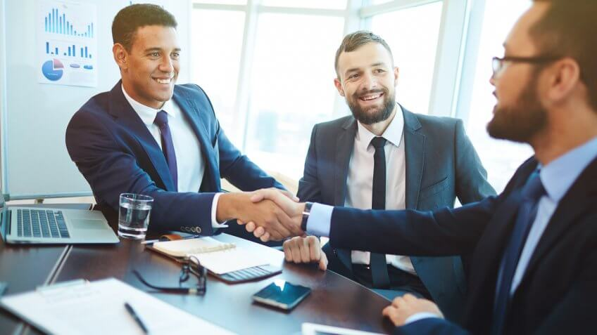 businessmen shaking hands at a meeting