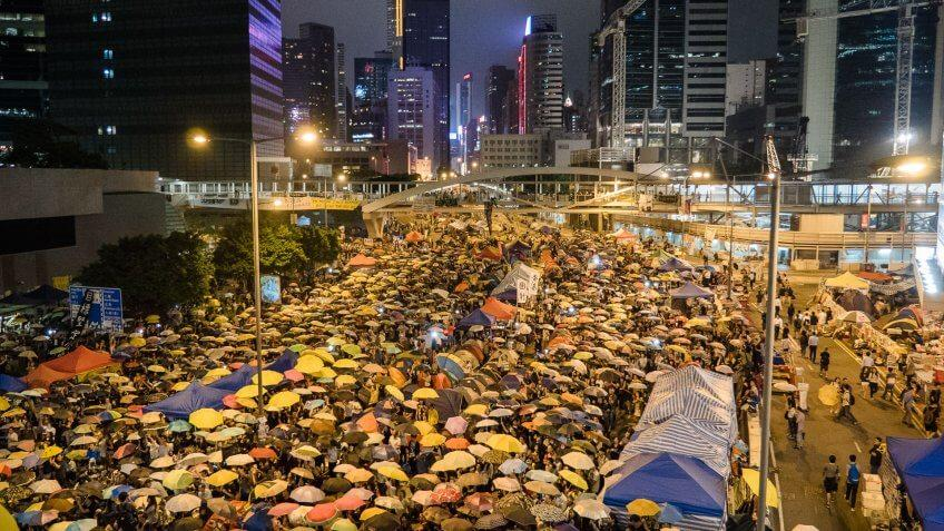 protesters crowding a city