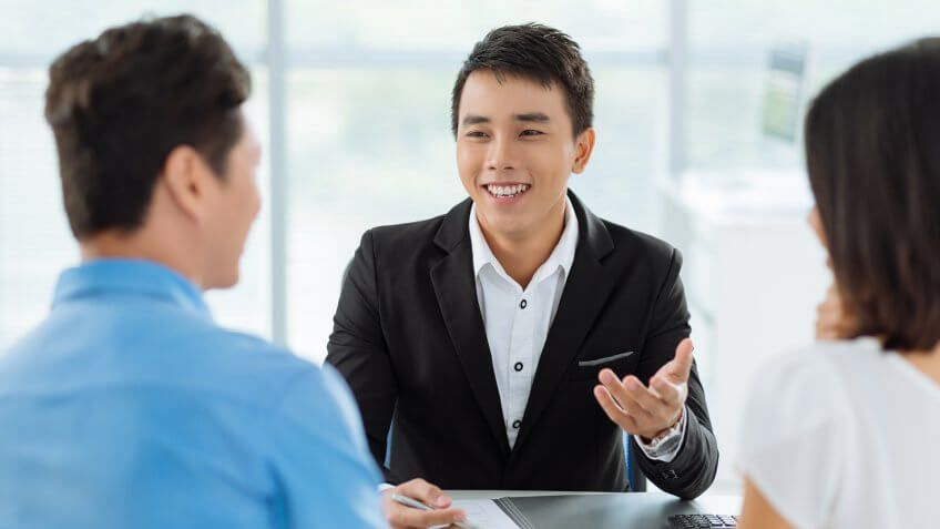 asian couple talking to a professional