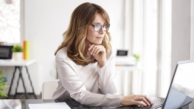 businesswoman working on laptop in her workstation