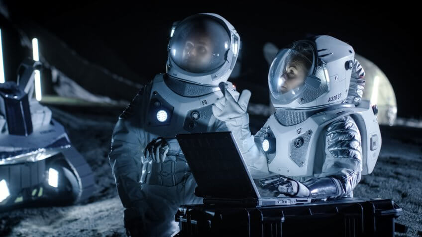 Two Astronauts Wearing Space Suits