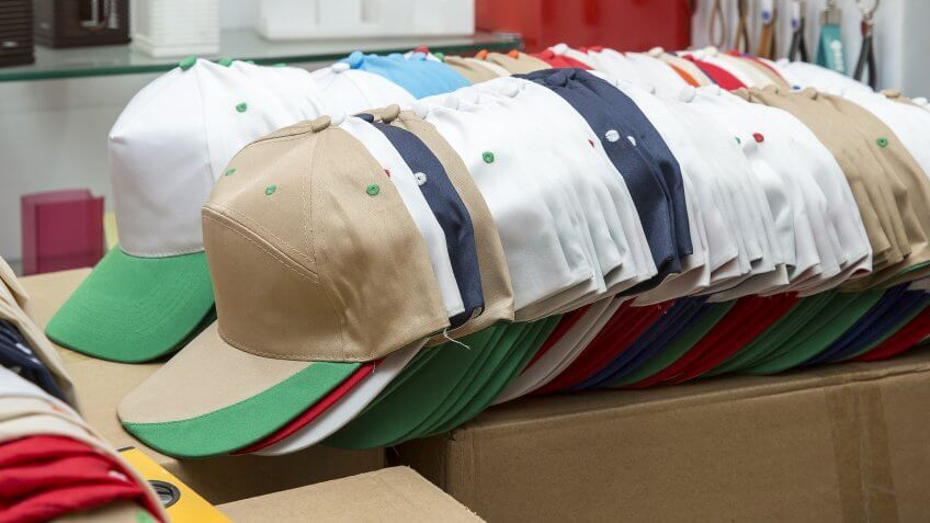 stack of hats caps