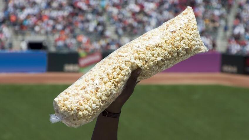person holding a large bag of popcorn