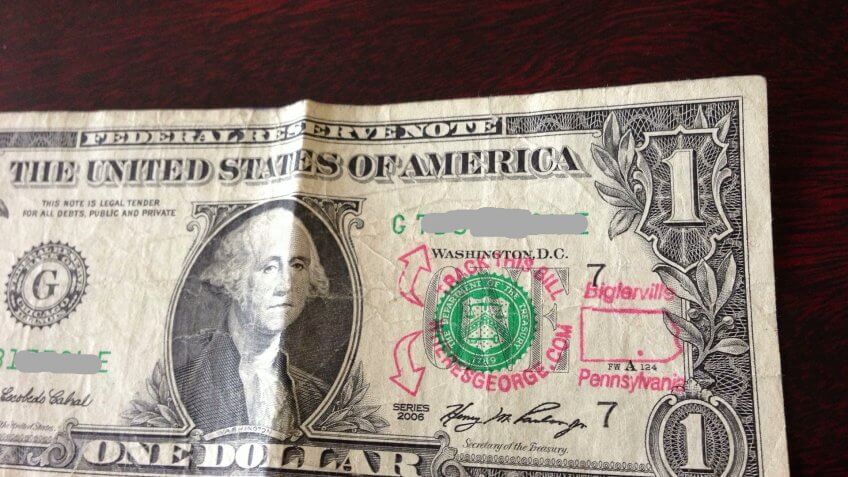 US dollar bill with Where's George? tracking