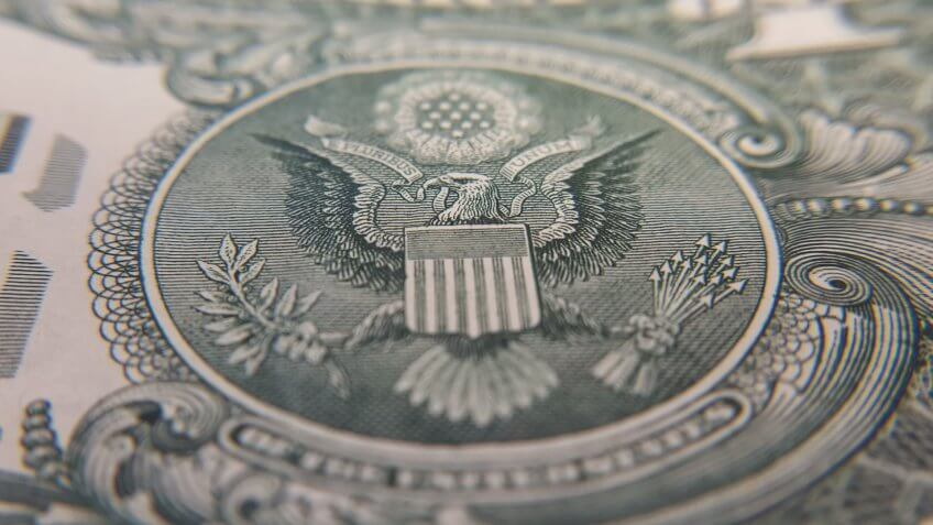 close up of back of US dollar bill
