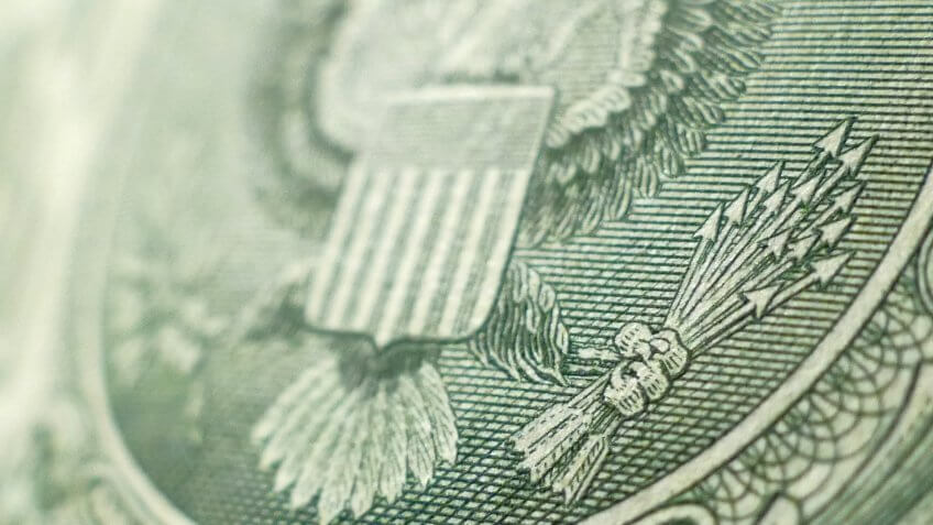 close up of US dollar bill eagle and arrows