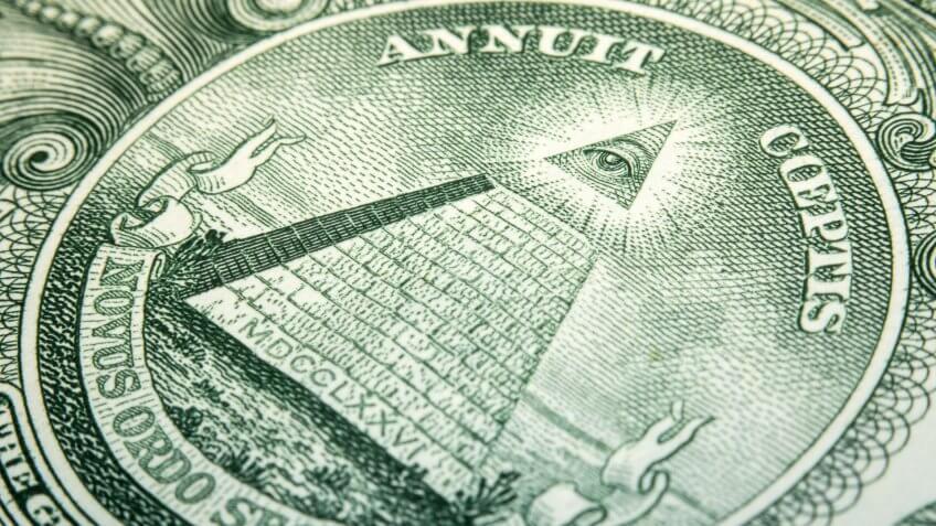 close up of US dollar bill pyramid