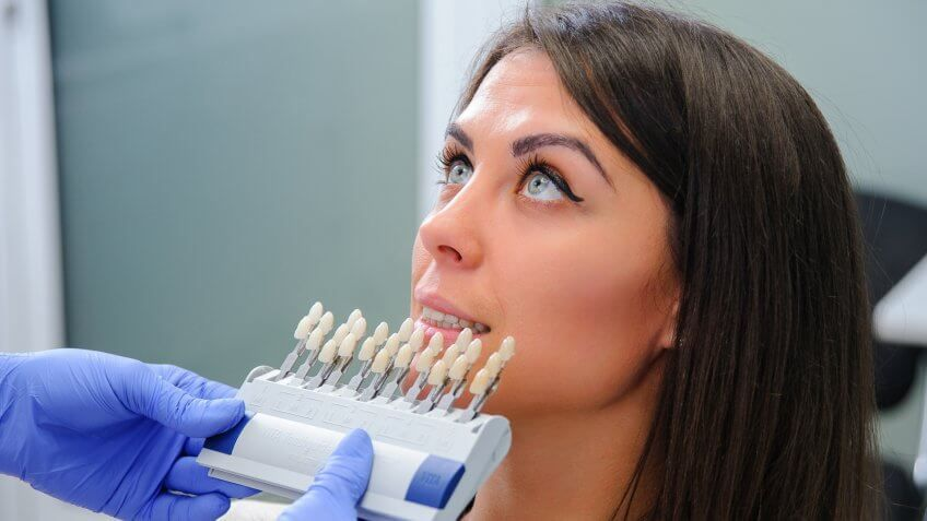 woman at the dentist getting dental implants