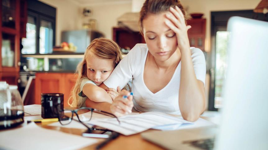 Close up of a mother going through her financials.