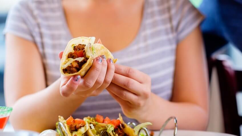 woman holding a taco
