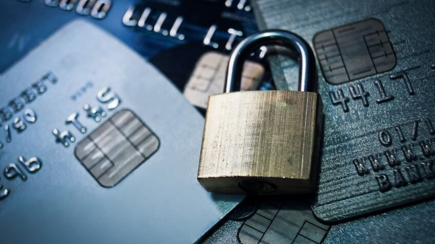 padlock on a stack of credit cards