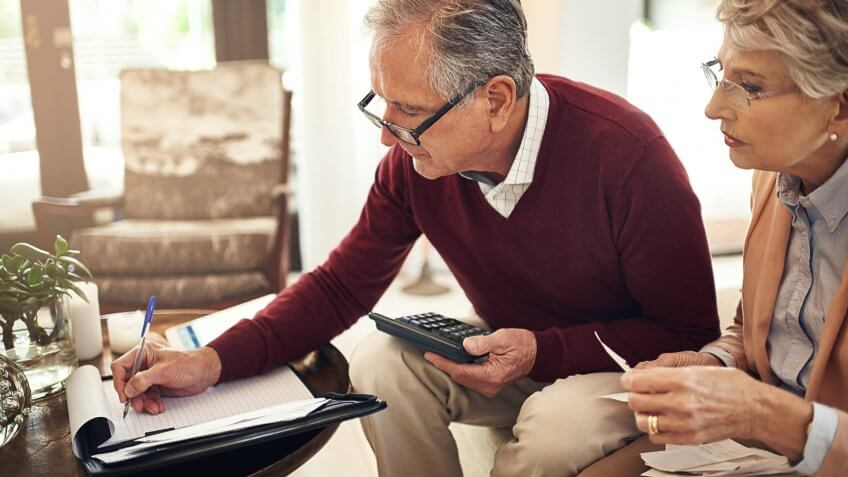 old senior retired couple calculating finances