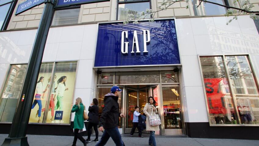 NEW YORK CITY - APRIL 19: Shoppers walk past a Gap retail outlet in New York City, on Friday, April 19, 2013.