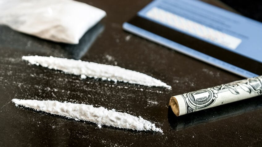 rolled up US dollar bill and cocaine