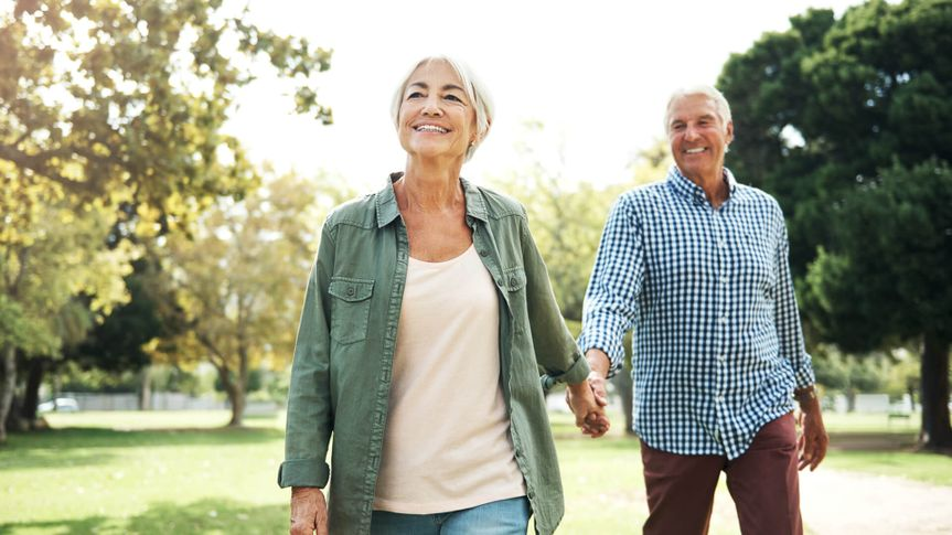 Shot of a happy senior couple going for a walk in the park.