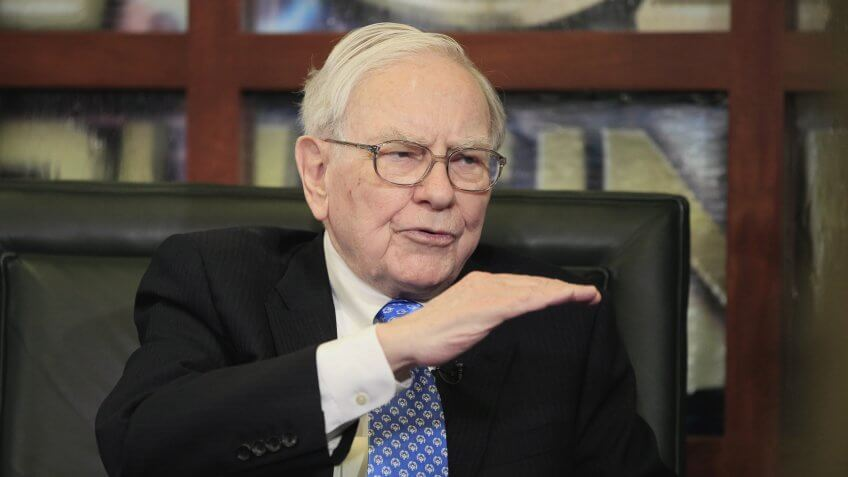 Mandatory Credit: Photo by Nati Harnik/AP/REX/Shutterstock (5933229a)Warren Buffett Warren Buffett, Chairman, President & CEO of Berkshire Hathaway, gestures during an interview with Liz Claman of the Fox Business Network, in Omaha, Neb.