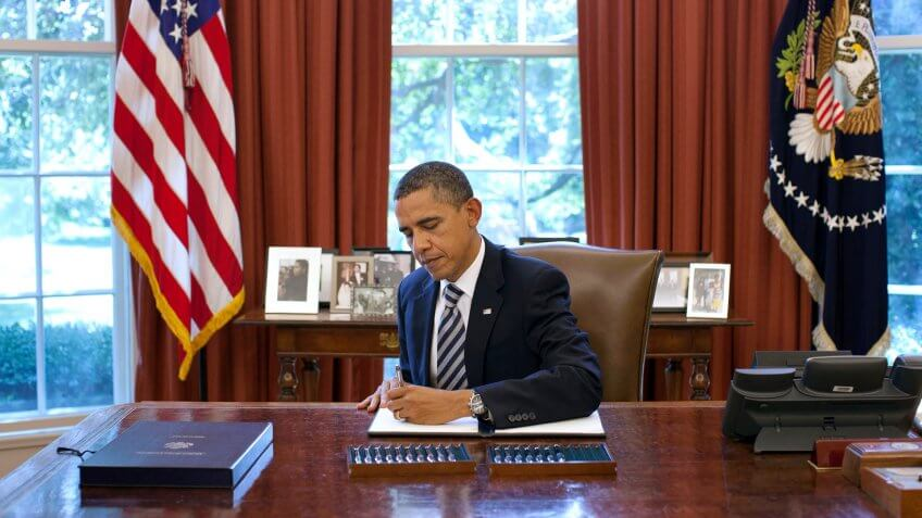 President Barack Obama signs the Budget Control Act of 2011 in the Oval Office, Aug.