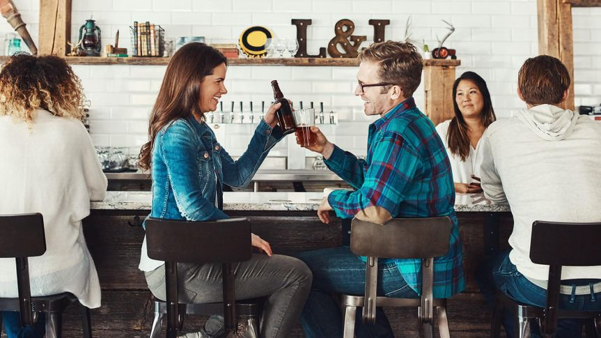 young people enjoying a drink at a bar